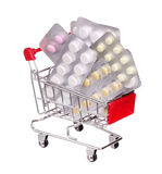 Pills in shopping cart isolated on white background Stock Image