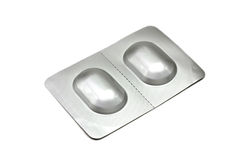 Pills in a silver box Stock Images