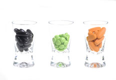 Pills in small glasses Stock Photography