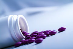 Pills. Some purple pills and tablets Stock Images