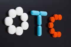 Pills spell out OTC Stock Photos