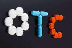 Pills spell out OTC stock photos