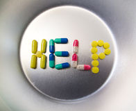Pills spelling word help Royalty Free Stock Image