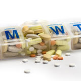 Pills spill out of a dossette box Stock Photo