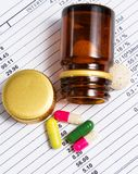 Pills spilling from bottle closeup Royalty Free Stock Photo