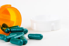 Pills. Pills spilling out of the bottle Royalty Free Stock Photo