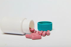pills spilling out of pill bottle. Background Royalty Free Stock Photo
