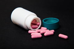 pills spilling out of pill bottle. Background Stock Photo