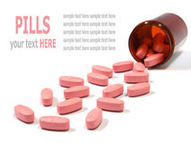 Pills spilling out of a pill bottle isolated Royalty Free Stock Photos