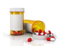 Pills spilling out of pill bottle . Stock Image