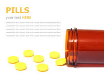 Pills spilling out of a pill bottle isolated on white Royalty Free Stock Images
