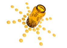 Pills spilling out of pill bottle isolated on Royalty Free Stock Image