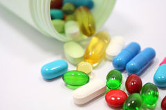 Pills spilling out of pill bottle Stock Photos
