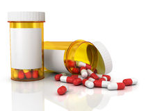 Pills spilling out of pill bottle Royalty Free Stock Image