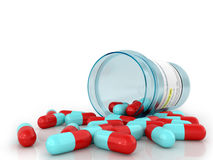 Pills spilling out of pill bottle Royalty Free Stock Images