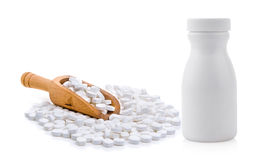 Pills spilling out of pill bottle. On a white background Stock Photos