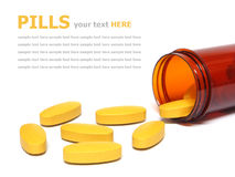 Pills spilling out of a pill bottle  on white Stock Image
