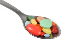 Pills on Spoon Royalty Free Stock Photos