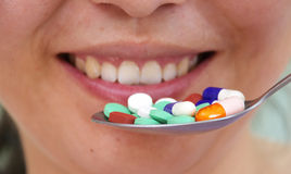 Pills in spoon Royalty Free Stock Photography