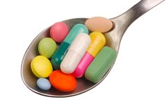 Pills on Spoon Stock Photography