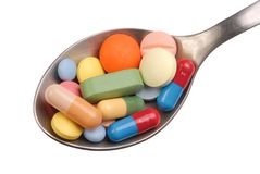 Pills on Spoon Royalty Free Stock Image