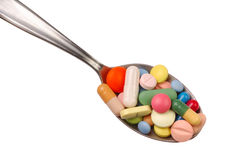 Pills on Spoon Royalty Free Stock Images