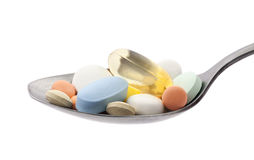 Pills on spoon with clipping path Royalty Free Stock Photo