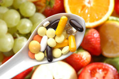 Pills spoon fruits Royalty Free Stock Photos