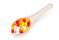 Pills in a spoon Stock Photo