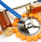 Pills and stethoscope for diagnosing stock images