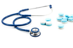Pills and stethoscope Royalty Free Stock Image