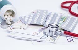 Pills stethoscope and money Stock Photo