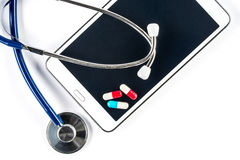 Pills and Stethoscope with Tablet, Capsule on Touch Screen Royalty Free Stock Photo