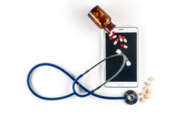 Pills and Stethoscope with Tablet, Touch Screen Royalty Free Stock Photos