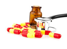 Pills and stethoscope Stock Images