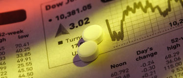 Pills on Stock Price Chart Stock Photography