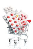 Pills in a supermarket shopping trolley Stock Image