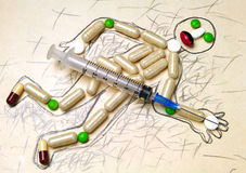 Pills and a syringe Royalty Free Stock Photos