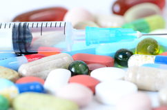Pills and syringe Stock Image