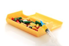 Pills and syringe. Royalty Free Stock Images