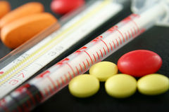 Pills, syringe and thermometer Stock Images