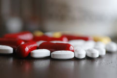Pills on table Stock Images