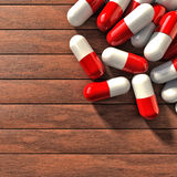 Pills on table. Several pills on a wood table Stock Photos