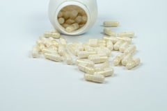 Pills on a Table. White pills isolateted on a white table Stock Images