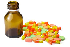 Pills and tablet bottle isolated in white Stock Photo