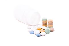 Pills and tablets. Near the can isolated over white Stock Image
