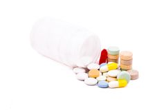 Pills and tablets. Near the can isolated over white Royalty Free Stock Photography