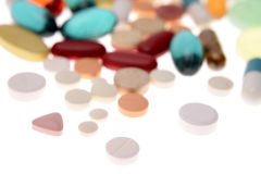 Pills and tablets. On white Stock Photography