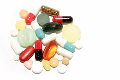 Pills and tablets. Assorted pills and tablets on white background Royalty Free Stock Photo