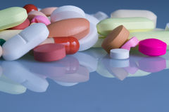 Pills and tablets. Blue tone Stock Photography